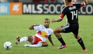 New York Red Bulls forward Thierry Henry (14) knocks a pass forward to teammate Joel Lindpere (20), not pictured, and past D.C. United midfielder Andy Najar (14) during first-half action at RFK Stadium in Washington, D.C., Wednesday, August 29, 2012. (Chuck Myers/MCT)
